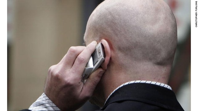 MANCHESTER, UNITED KINGDOM - JANUARY 20: An unidentified man uses his mobile telephone without ear piece on January 20, 2006 in Manchester, England. A longterm study has found that there is no link between mobile phone use and tumours. The study of 2,782 people in the UK showed that excessive use matched other surveys concluding the results. (Photo by Christopher Furlong/Getty Images)