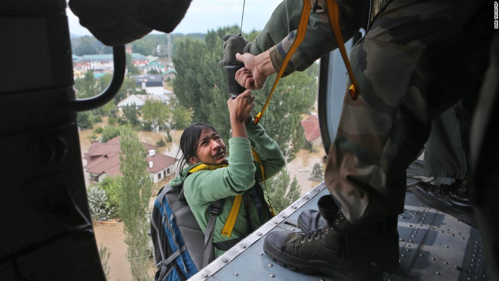 A tourist cries as she is airlifted into a chopper in Srinagar on September 9.