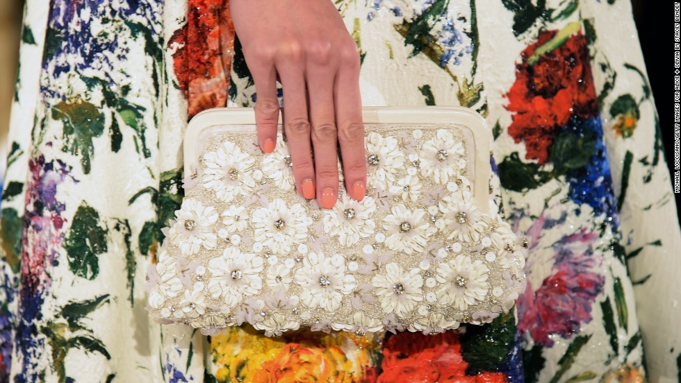 A model held a delicate, daisy-decorated clutch during the alice + olivia presentation.