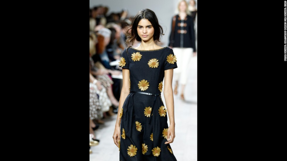 "Michael Kors decorated a 1950s, ""postwar"" silhouette with daisy appliqués."