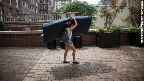 Emma Sulkowicz of Columbia University carries a mattress in protest of the university's lack of action after she reported being raped.