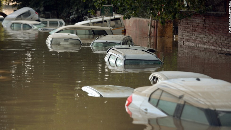 Submerged cars are seen on a flooded street in Srinagar on Thursday, September 11.