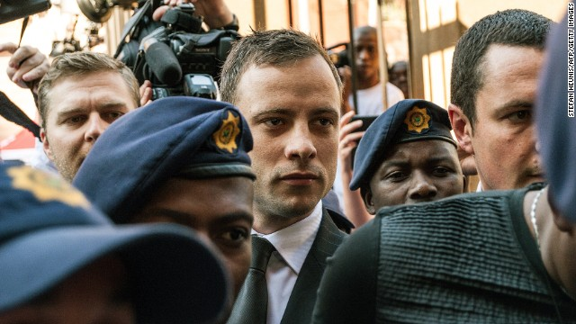 South African Paralympian athlete Oscar Pistorius(C) arrives at the High Court in Pretoria on September 12, 2014.