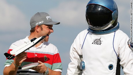 ndy Sullivan of England poses with his trophy and an astronaut from the XCOR space ship after the final round of the KLM Open held at De Kennemer Golf and Country Club on September 14, 2014 in Zandvoort, Netherlands. XCOR Space Expeditions is giving Andy Sullivan a space excursion, valued at $195,000, after he made a hole-in-one on the 163-yard, par-3 15th hole.