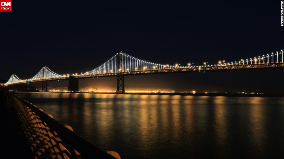 "The San Francisco-Oakland Bay Bridge illuminates the San Francisco Bay in California. <a href=""http://ireport.cnn.com/docs/DOC-1064986"">Paul Heller</a>, who shot this photo in November 2013, described it as ""a beautiful scene."""