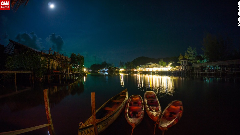 """Fishing boats gently bob in the evening waters of Klong Prao Beach in <a href=""""http://ireport.cnn.com/docs/DOC-1127842"""">Koh Chang</a>, Thailand."""