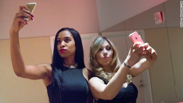 "Allison, 22, and Serena, 23, snap a selfie at a party where they and other ""sugar babies"" can meet ""sugar daddies,"" older, wealthy gentlemen who are willing to exchange money and gifts for their companionship."