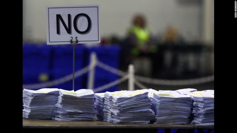 Ballots cast against Scottish independence get stacked on a table as votes are counted in Edinburgh on September 19.