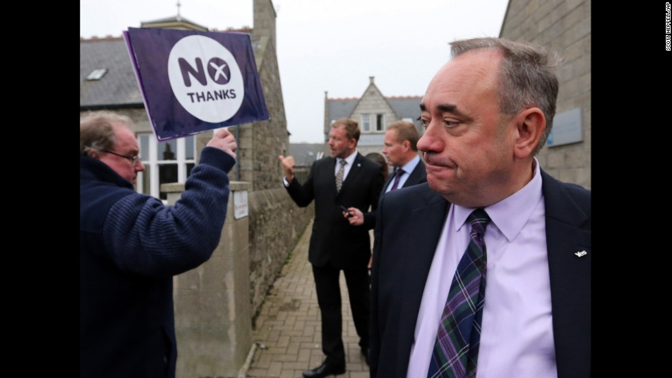 Scottish First Minister Alex Salmond passes an pro-union campaigner in Ellon, Scotland, on September 18. Salmond, leader of the independence movement, later accepted defeat and urged supporters to do the same.