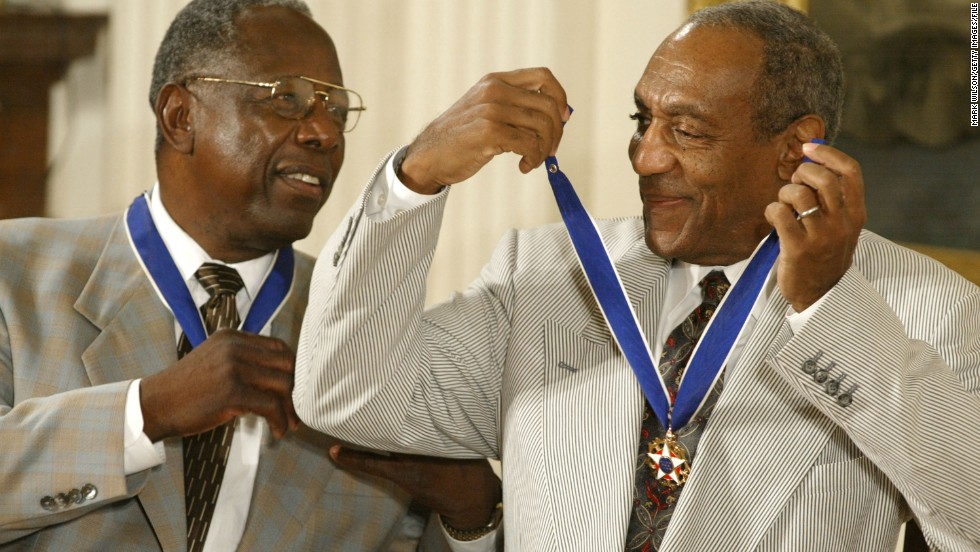 Cosby shares a laugh with baseball great Hank Aaron after they both received the Presidential Medal of Freedom during a 2002 ceremony. The medal is America's highest civilian award.