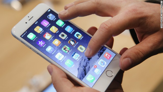 A shopper ltries out the new Apple iPhone 6 at the Apple Store on the first day of sales of the new phone in Germany on September 19, 2014 in Berlin, Germany.