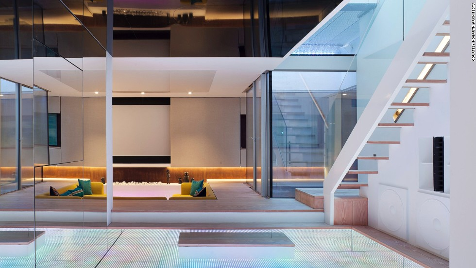 "<a href=""http://www.hogartharchitects.co.uk/"" target=""_blank"">Hogarth Architects</a>-designed Hidden House's huge finished basement, light-up dance floor and waterfall were featured on the British homes show ""Grand Designs."""