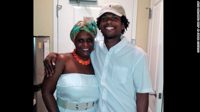 John Crawford III with his mother, Tressa Sherrod.