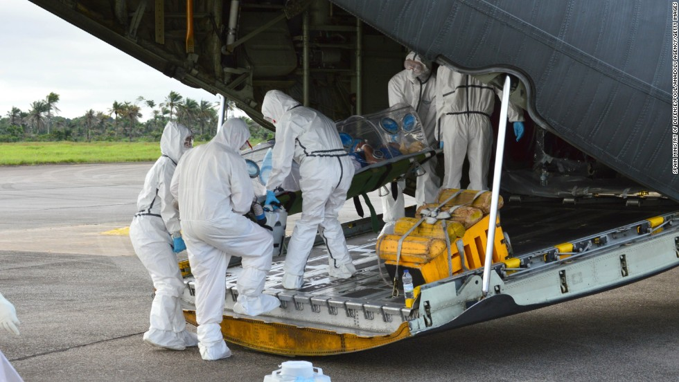 Medics load an Ebola patient onto a plane at Sierra Leone's Freetown-Lungi International Airport on September 22, 2014.