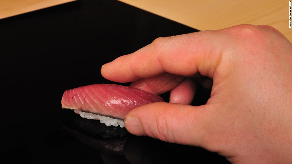 1. Grip the sushi -- don't squeeze.