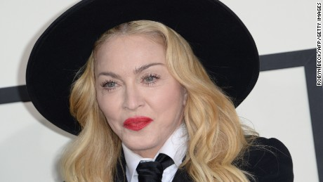 Performer Madonna poses on the red carpet  during the 56th Grammy Awards at the Staples Center in Los Angeles, California, January 26, 2014. AFP PHOTO ROBYN BECK        (Photo credit should read )