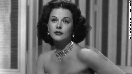 circa 1940: Studio portrait of Austrian-born actor Hedy Lamarr (1913-2000) wearing a strapless gown and glittering jewelry, sitting with her hand on her hip. (Photo by Hulton Archive/Getty Images)