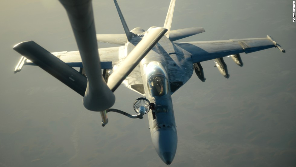 "A U.S. Navy jet is refueled in flight after airstrike missions in Syria on September 23. In addition to bombing ISIS, the United States has also taken action -- on its own -- against another terrorist organization, the Khorasan Group. U.S. President Barack Obama described Khorasan members as ""seasoned al Qaeda operatives in Syria."""