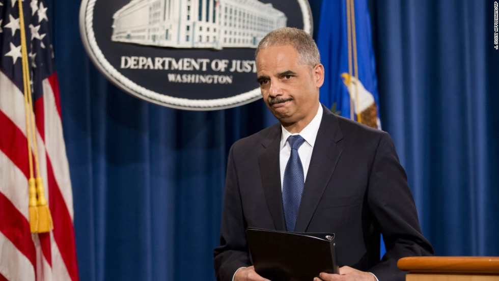 Holder leaves after speaking of his disappointment in a Supreme Court ruling that declared a key part of the Voting Rights Act unconstitutional in June 2013.