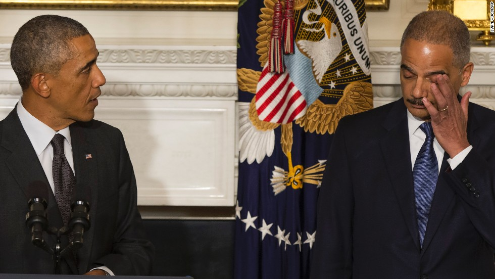 "Holder wipes away tears in September 2014 as <a href=""http://www.cnn.com/2014/09/25/politics/eric-holder-resignation/index.html"">his resignation is announced</a> by President Barack Obama in Washington. Holder, who led the Department of Justice for six years, stayed in the position until his replacement, Loretta Lynch, was confirmed."