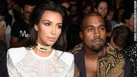 PARIS, FRANCE - SEPTEMBER 25: (L-R) Kim Kardashian and Kanye West attend the Balmain show as part of the Paris Fashion Week Womenswear Spring/Summer 2015 on September 25, 2014 in Paris, France. (Photo by Pascal Le Segretain/Getty Images)