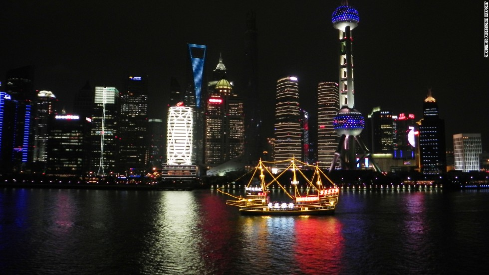 "The vibrant glow of <a href=""http://ireport.cnn.com/docs/DOC-1131116"">Pudong</a>, a waterfront area in central Shanghai, reflects against the calm waters of China's Huangpu River. Get to know Shanghai better during the premiere of CNN's <a href=""http://cnn.com/video/shows/anthony-bourdain-parts-unknown/"">""Anthony Bourdain: Parts Unknown""</a> on Sunday, September 28, at 9 p.m. ET."