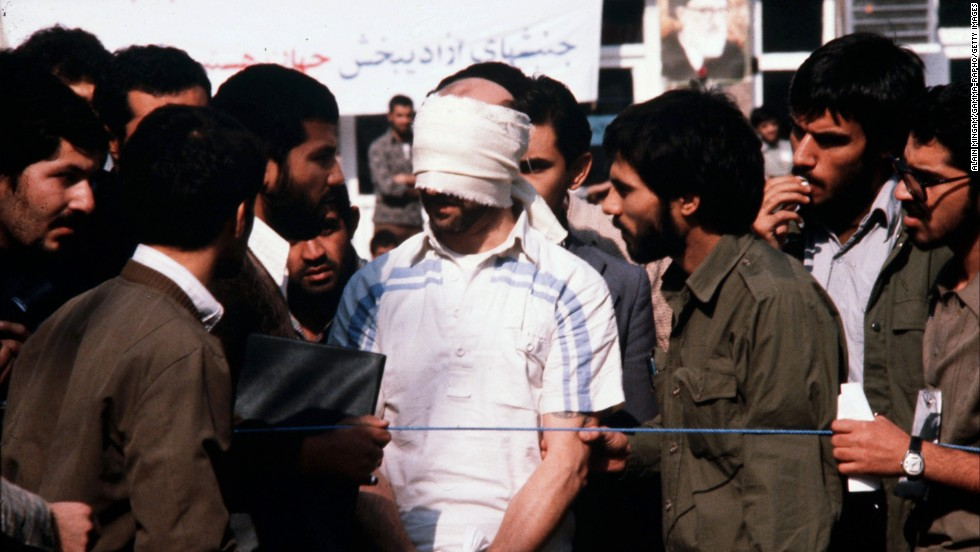 A blindfolded American hostage is paraded by his captors at the U.S. Embassy in Tehran, Iran, in November 1979. Carter's inability to successfully negotiate the release of the hostages became a major political liability. The hostages were freed on January 20, 1981, the day of Ronald Reagan's inauguration.