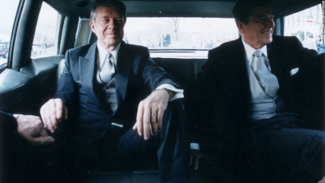 Outgoing President Jimmy Carter, left, sits with president-elect Ronald Reagan in the back of a limousine en route to Reagan's inauguration on January 20, 1981.