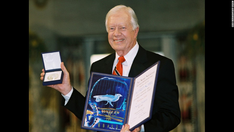 Carter is awarded the Nobel Peace Prize in Oslo, Norway, in December 2002. He was recognized for his many years of public service, and in his acceptance speech he urged others to work for peace.