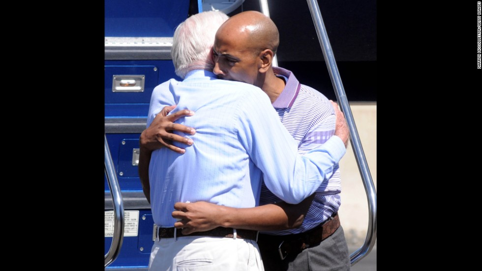 Carter hugs Aijalon Mahli Gomes at Boston's Logan International Airport in August 2010. Carter negotiated Gomes' release after he was held in North Korea for crossing into the country illegally in January 2010.