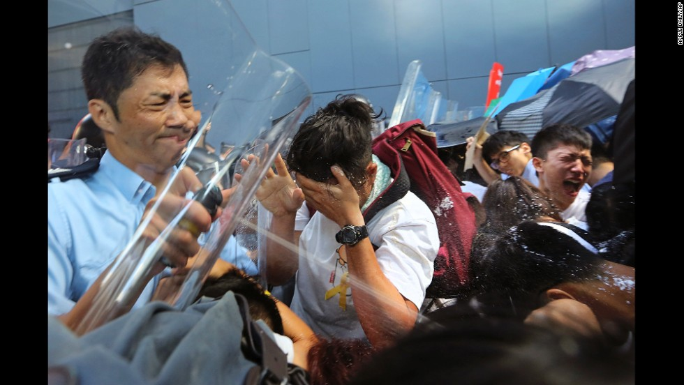 Riot police use pepper spray on pro-democracy activists who forced their way into the Hong Kong government headquarters during a demonstration on September 27.