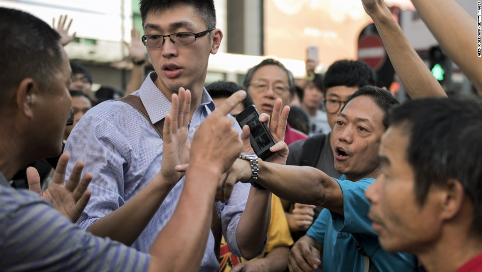 Pro-democracy protesters argue with a man, left, who opposes the occupation of Nathan Road in Hong Kong on September 29.