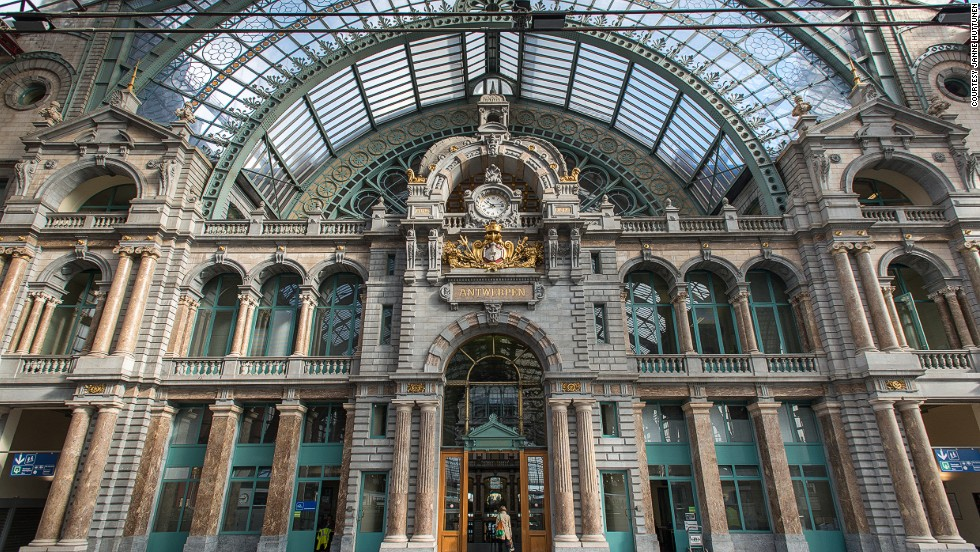"The stone-clad Antwerpen-Centraal is such an eclectic mix of designs that it has no designated architectural style. Its vast dome covering the waiting room and vast iron and glass train shed earned the station the nickname ""Railway Cathedral."""