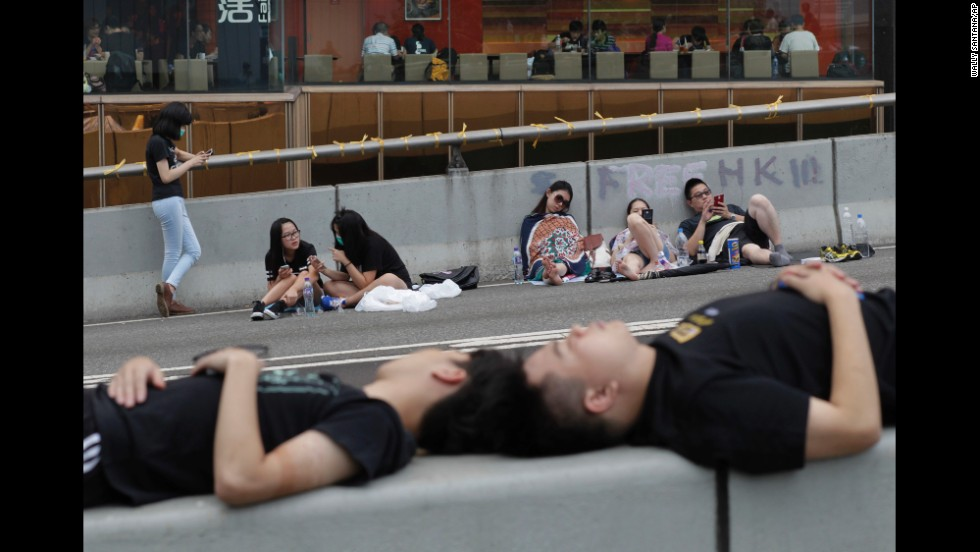 Pro-democracy demonstrators sleep on the street outside a government complex in Hong Kong on Thursday, October 2.