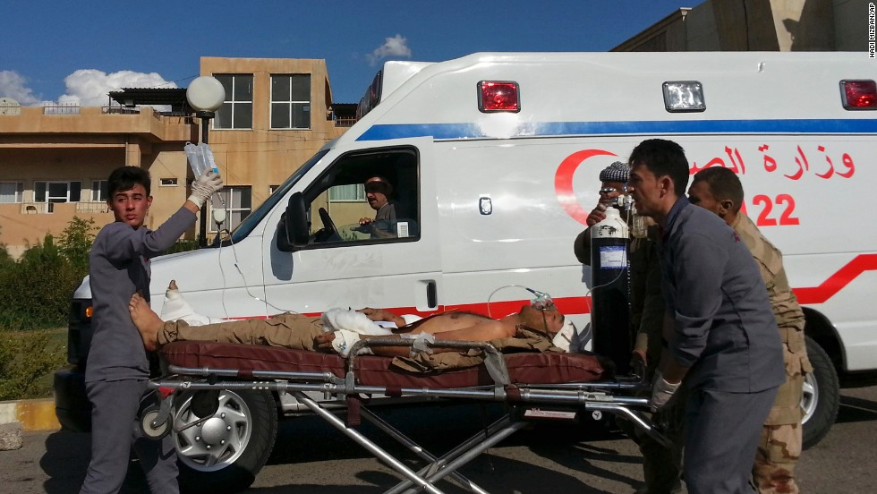 A Kurdish Peshmerga infantryman who was bleeding in a dispute with ISIS is wheeled to a Zakho Emergency Hospital in Duhuk, Iraq, on Tuesday, Sep 30.