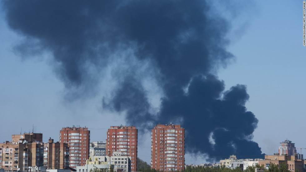 Smoke rises from the area near the Donetsk airport after heavy shelling on October 2.