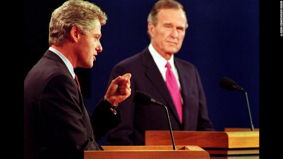 Clinton debates President George H.W. Bush and independent candidate H. Ross Perot (not pictured) at Michigan State University in Lansing, on October 19, 1992. It was their third and final debate.