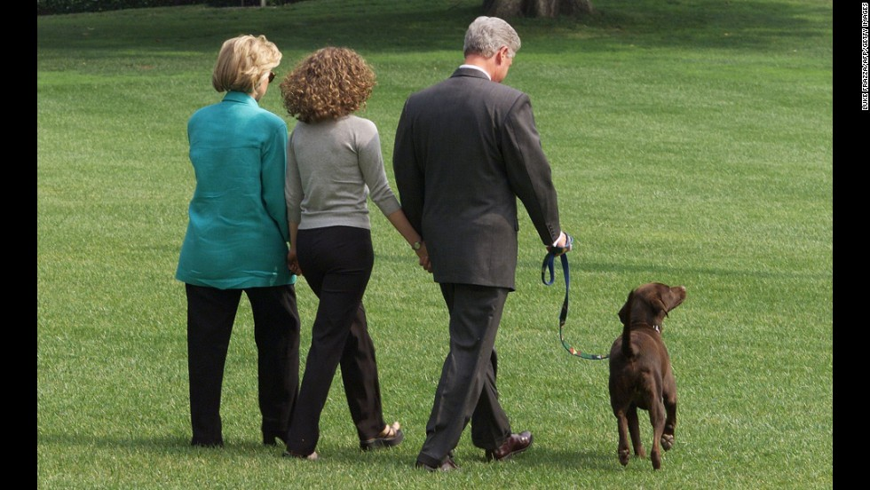 Hillary, Chelsea and Bill Clinton depart the White House with Buddy on August 17, 1994.