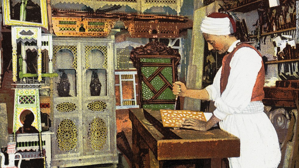 """This over-painted 1926 card shows an """"Arab carpenter"""" at work. It's not clear which country the card depicts."""