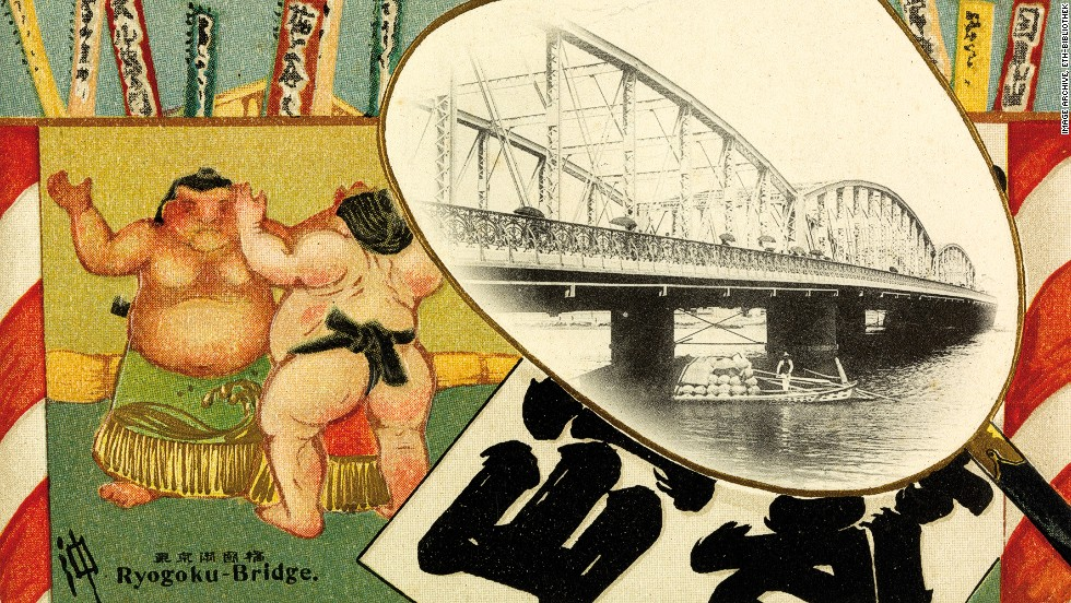 Cartoon-like sumo wrestlers are seen in this 1924 card that also depicts Japan's Ryugoku Bridge.