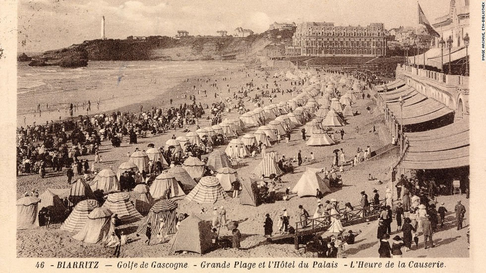 Rows of tents are seen on the beach in this card from France's swanky coastal resort of Biarritz dated 1929.