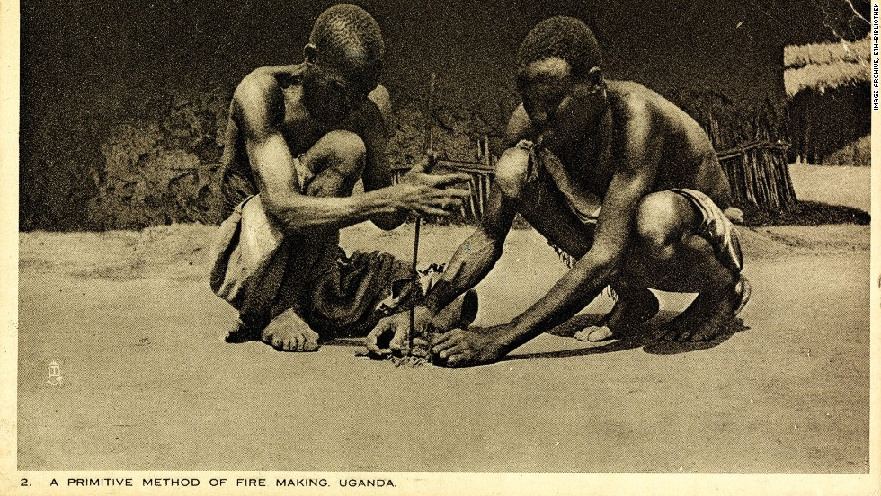 """Sent just two years before Feller's death in 1931, this postcard shows two men in Uganda demonstrating, according to the caption, """"a primitive method of fire making."""""""