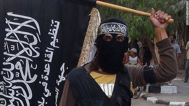 Caption:Islamic fighters from the al-Qaida group in the Levant, Al-Nusra Front, wave their movement's flag as they parade at the Yarmuk Palestinian refugee camp, south of Damascus, to denounce Israels military offensive on the Gaza Strip, on July 28, 2014. Israeli shells struck a UN school in Gaza early today, killing 16, as ground troops made a signficant push into the territory despite Palestinian efforts to broker a 24-hour truce. AFP PHOTO/RAMI AL-SAYED (Photo credit should read RAMI AL-SAYED/AFP/Getty Images)