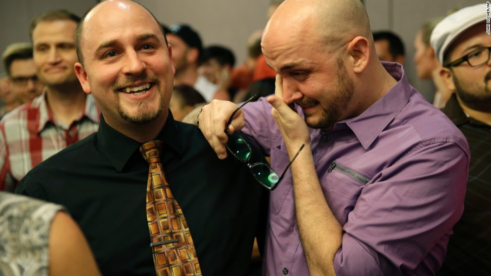 Joshua Gunter, right, and Bryan Shields attend a Las Vegas rally to celebrate an appeals court ruling that overturned Nevada's same-sex marriage ban on October 7, 2014.