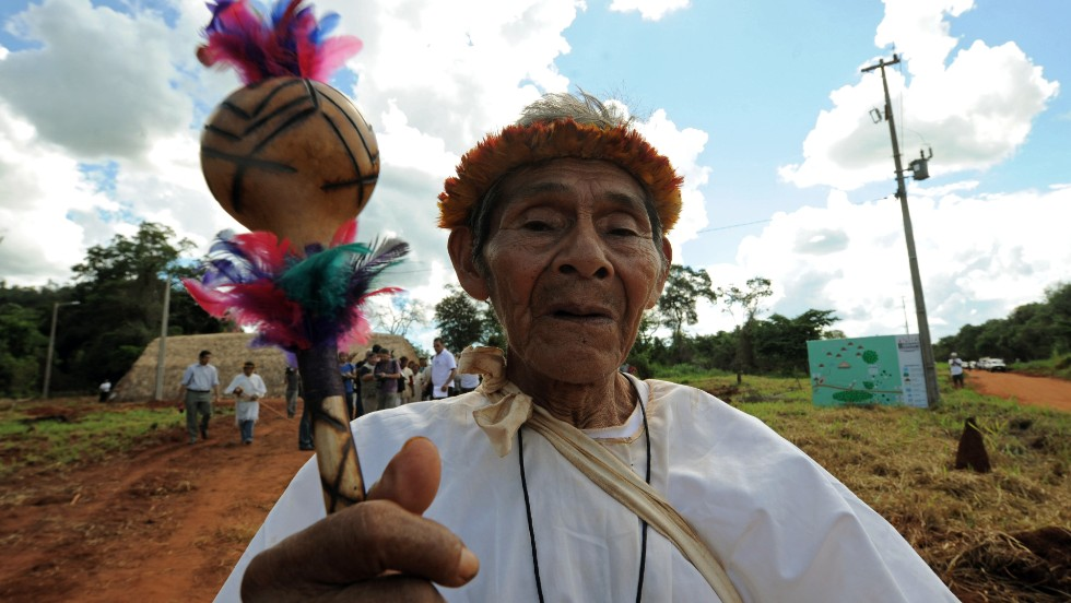 'A Paraguayan Guarani native takes part in a meeting of the Guarani Nation in 2011. Paraguay is the only country in the region with a large percentage of non-indigenous citizens who speak an indigenous language. Nearly 90 percent of all Paraguayans speak both Spanish and the indigenous Guarani.' from the web at 'http://i2.cdn.turner.com/cnnnext/dam/assets/141008163022-paraguay-guarani-native-horizontal-large-gallery.jpg'