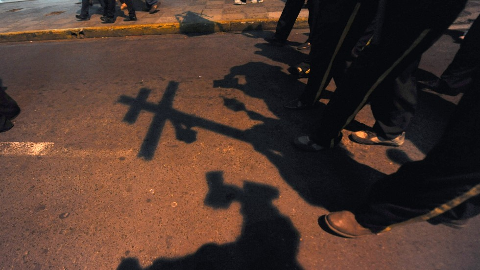 'A group marches during a candlelight procession in Asuncion on the eve of Kurusu Ara, or Day of the Cross, on May 2, 2012. The Catholic religious festival is combined with native Guarani traditions.' from the web at 'http://i2.cdn.turner.com/cnnnext/dam/assets/141008163513-paraguay-day-of-the-cross-horizontal-large-gallery.jpg'