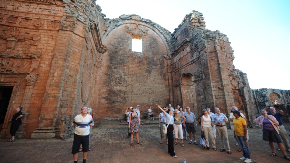 'Tourists visit the Trinidad mission in 2013. The missions fell into ruin after Spain expelled the Jesuits from the New World in 1767.' from the web at 'http://i2.cdn.turner.com/cnnnext/dam/assets/141008163704-paraguay-trinidad-ruins-horizontal-large-gallery.jpg'