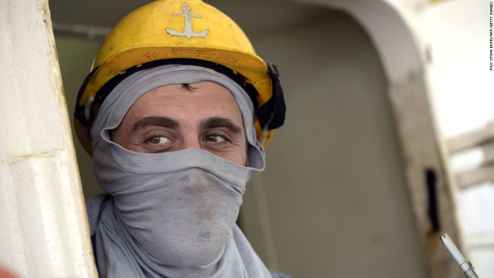 Here, a Ukrainian sailor uses a T-shirt as a face mask as he watches Nigerian health workers check the ship he's on for signs of the Ebola virus. The World Health Organization, or WHO, recommends a medical mask to adequately protect the mouth and nose.