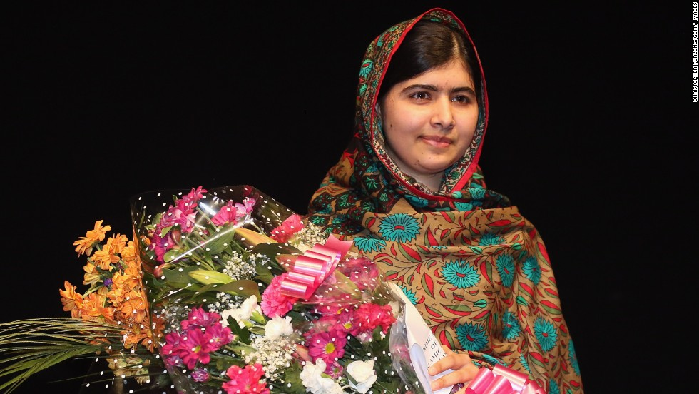 "Malala Yousafzai poses on stage in Birmingham, England, after she was announced as <a href=""http://www.cnn.com/2014/10/10/world/europe/nobel-peace-prize/index.html"">a recipient of the Nobel Peace Prize</a> on Friday, October 10, 2014. Two years earlier, she was shot in the head by the Taliban for her efforts to promote education for girls in Pakistan. Since then, after recovering from surgery, she has taken her campaign to the world stage."