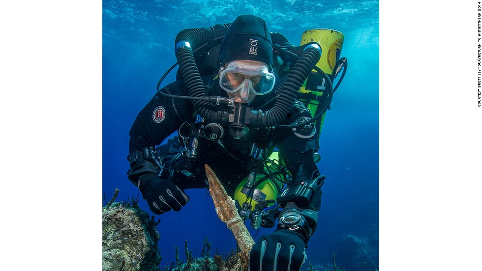 """""""Return to Antikythera"""" project chief diver Philip Short is pictured inspecting the magnificent two-meter-long bronze spear reclaimed from the shipwreck, which archaeologists say was once part of a life-size warrior statue."""